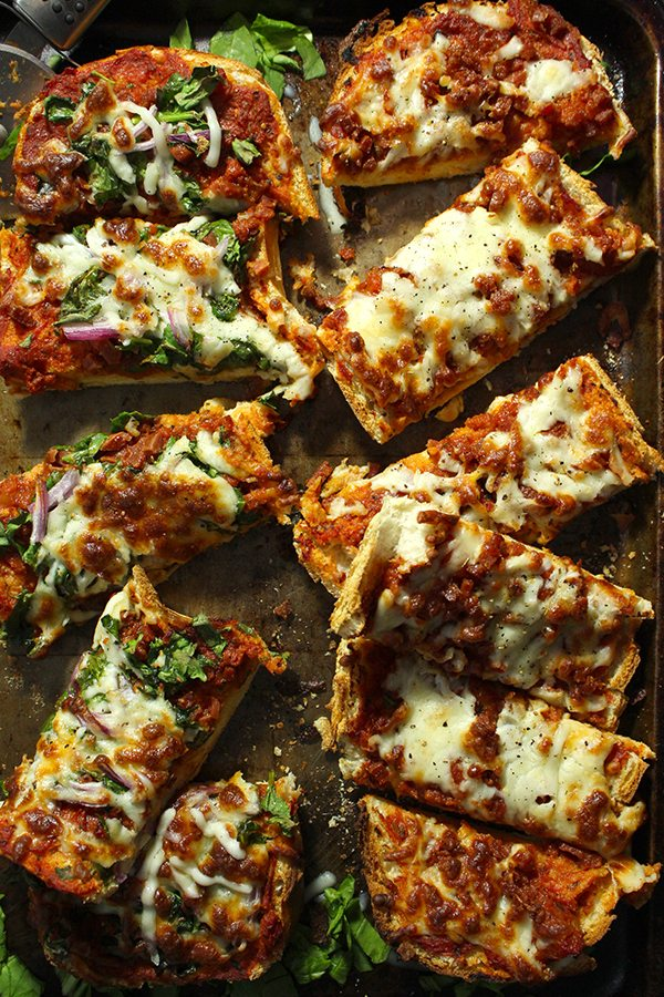 Sliced French Bread Pizza with basil and red onions