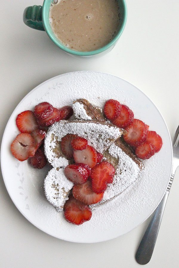 French toast with powdered sugar and strawberries on top