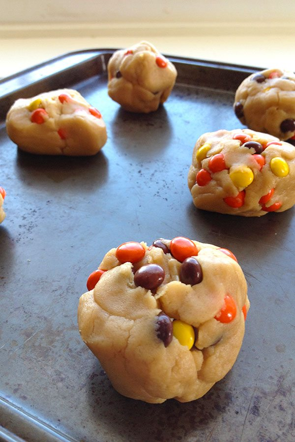 reeses pieces cookie dough on baking tray