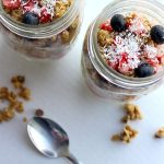 two yogurt parfaits with silver spoons