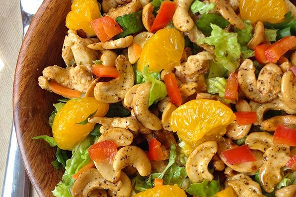 Chicken salad with nuts and fruit in bowl