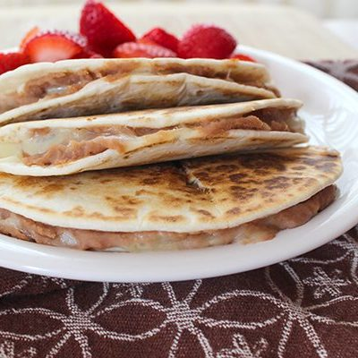 Cheese and Refried Bean quesadillas with fruit