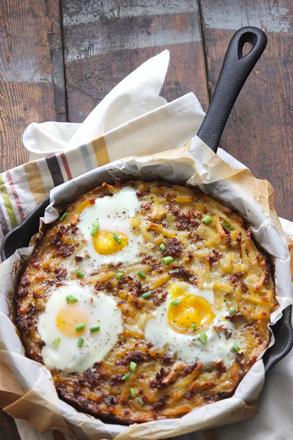 sausage egg hash brown casserole in cast iron skillet
