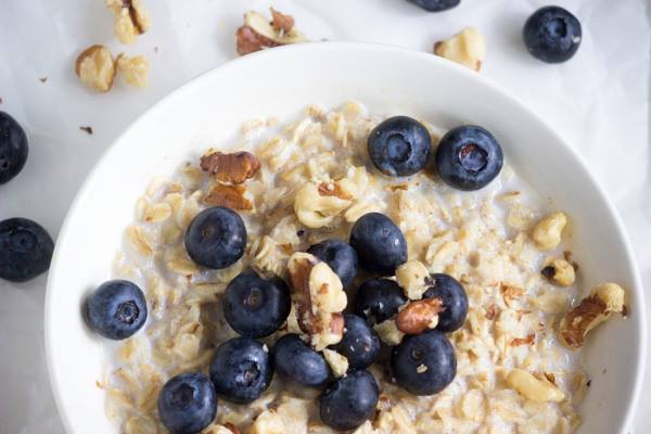 Blueberries mixed with oatmeal in bowl