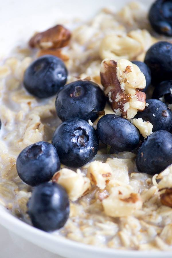 Oatmeal with blueberries in white bowl