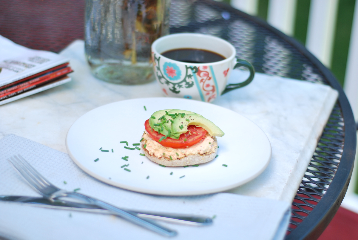 English muffin with vegetable cream cheese on plate