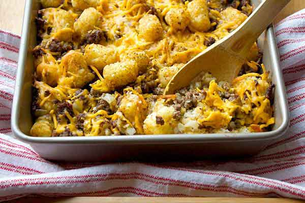 Hamburger Meat with Cheese and tater tot casserole in pan