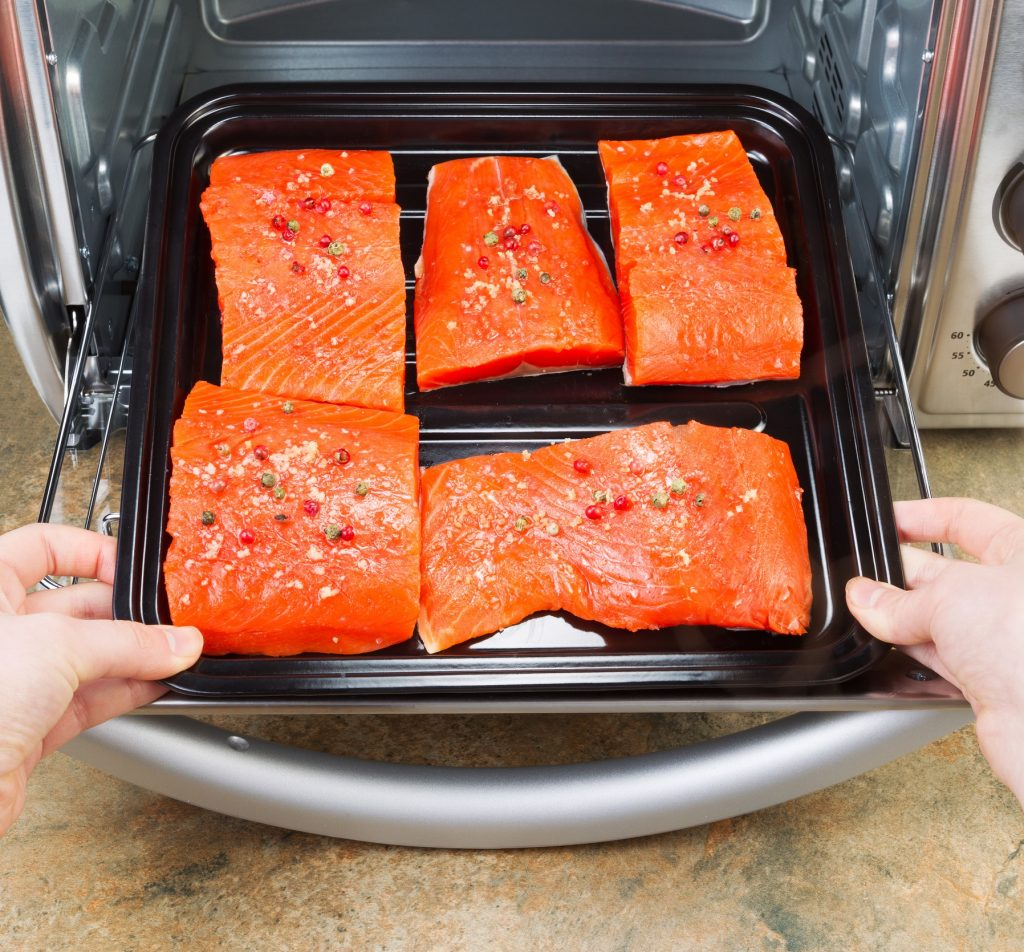 best countertop convection oven with salmon fillets inside