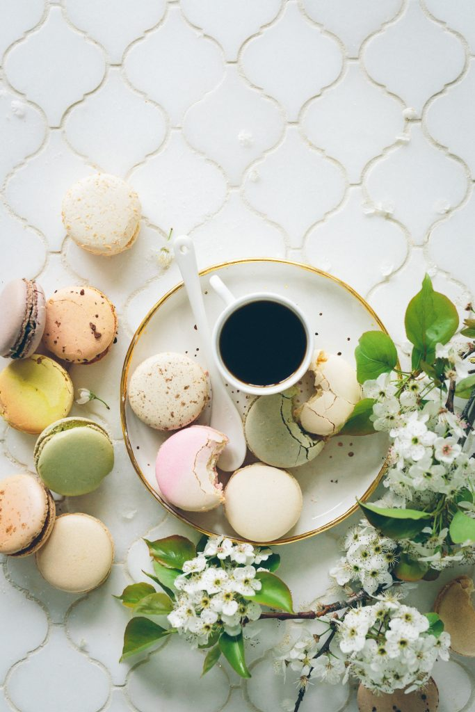 black coffee on white plate with macarons