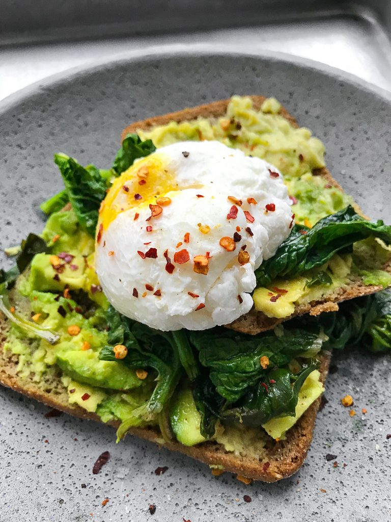 Cooked egg and avocado on bread