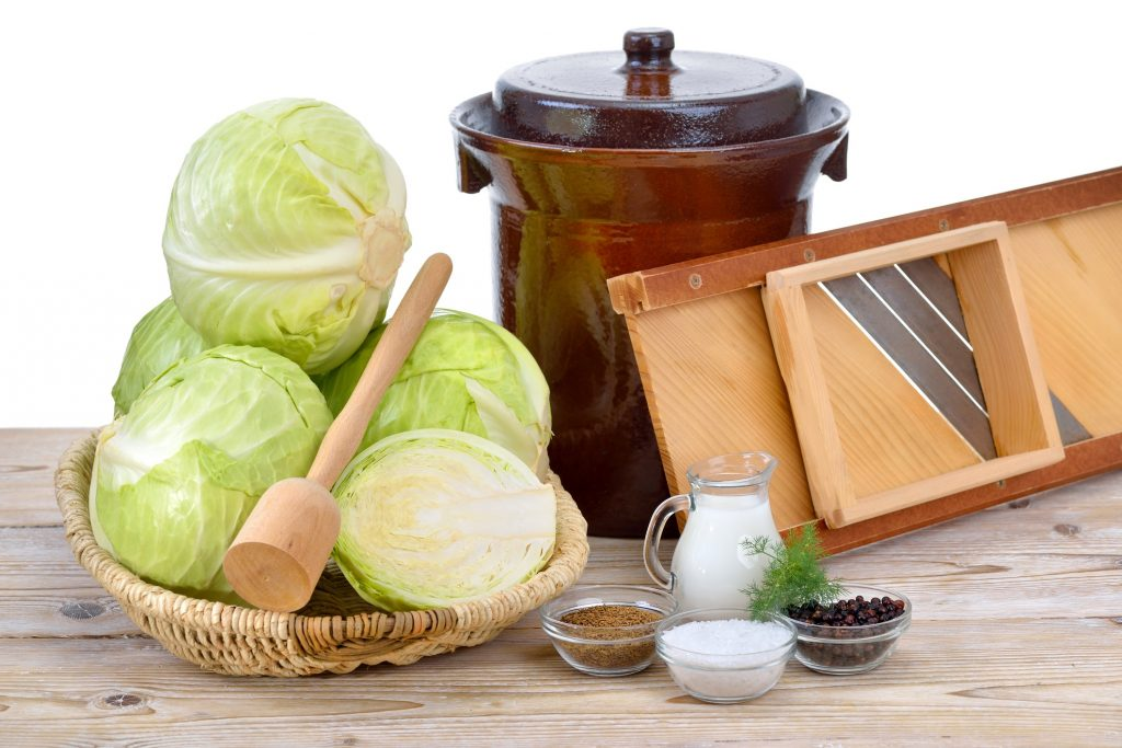 best fermentation crock next to basket of cabbage