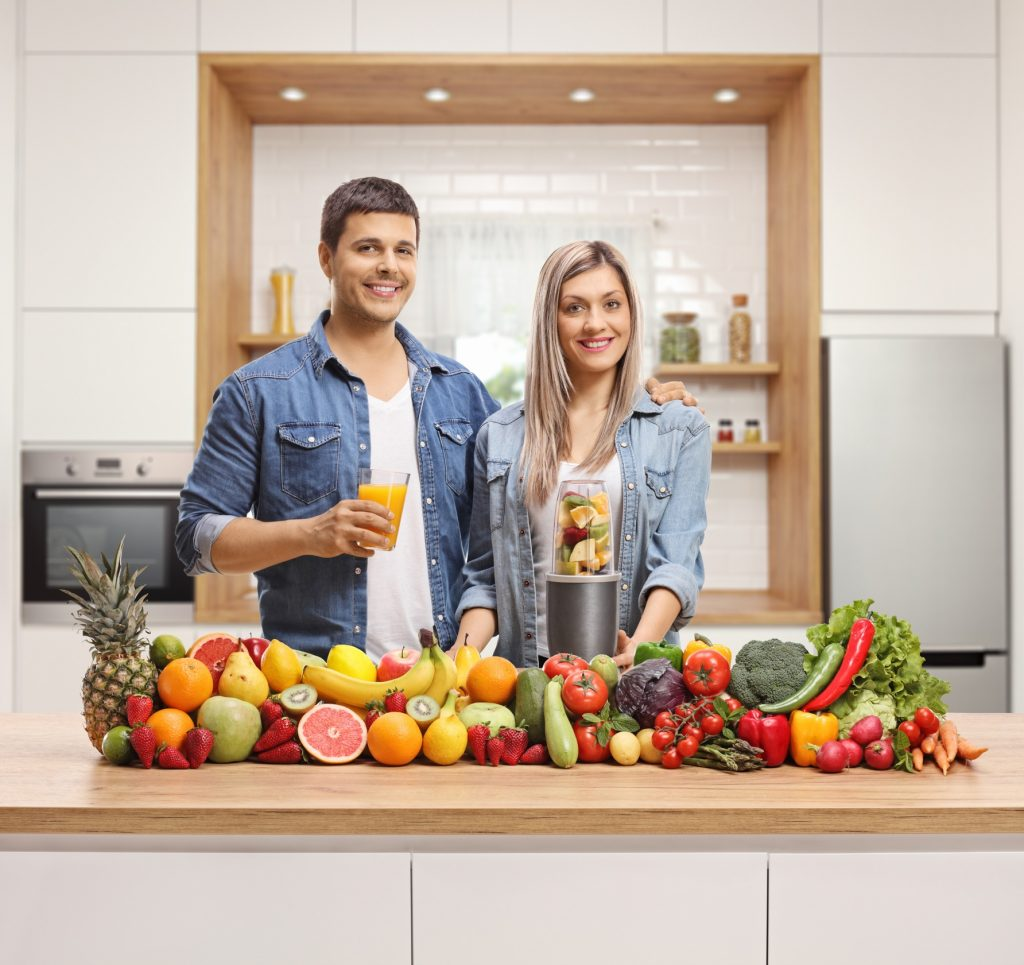 nutribullet magic bullet on counter with fruit and vegetables