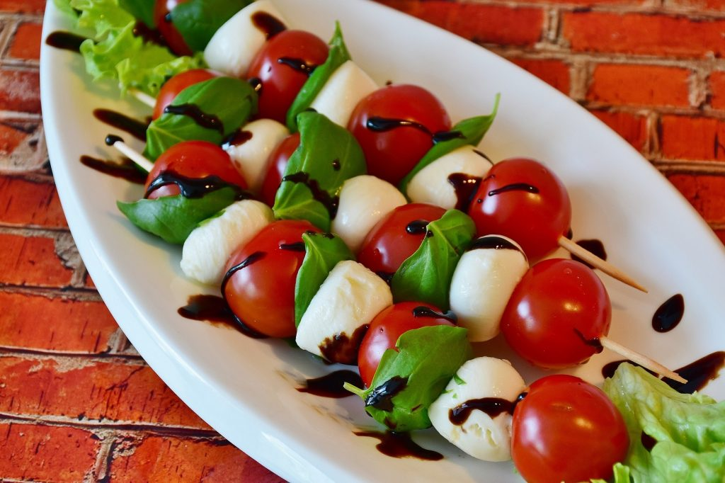 Tomato and mozzarella skewers drizzled with aged balsamic vinegar
