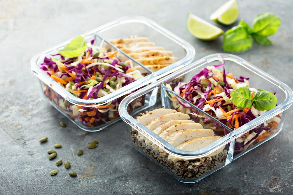 2 glass airtight food containers filled with chicken and cole slaw