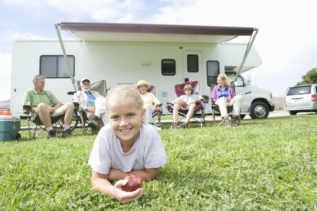 Family and girl in front of RV