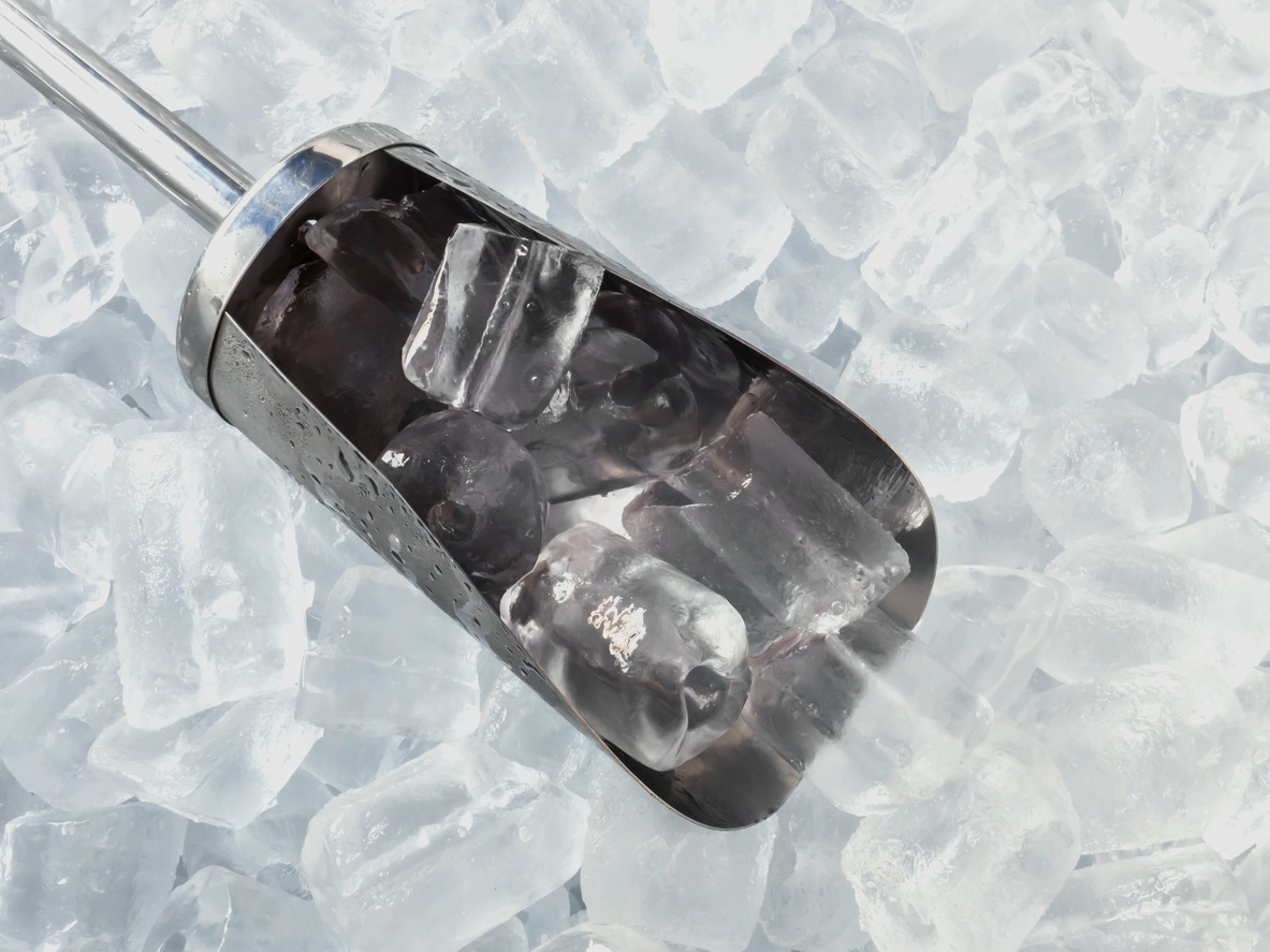 Ice cubes and stainless steel ice scoop