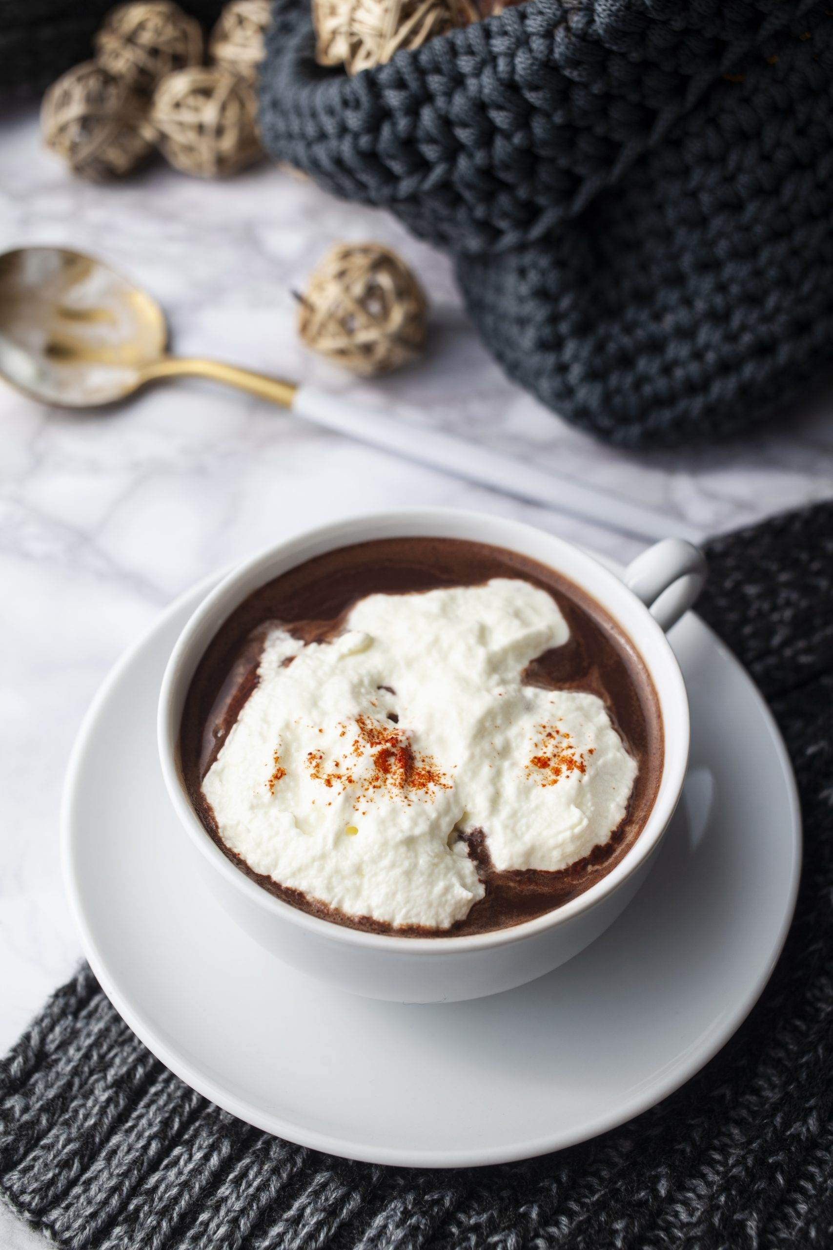 French style hot chocolate with whipped cream and hot pepper flakes