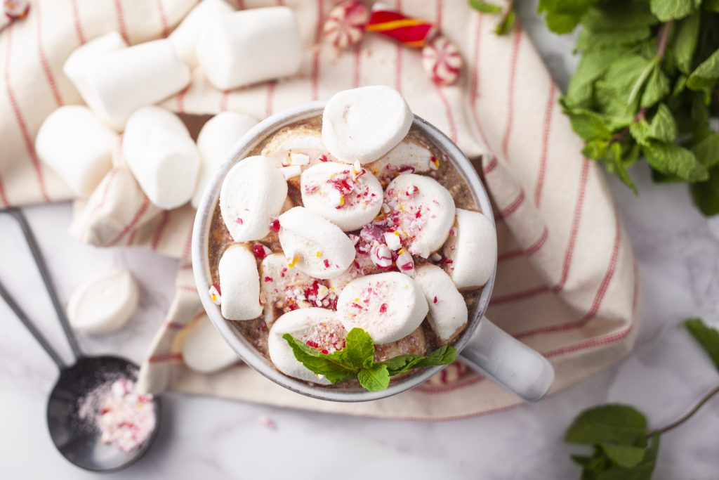 hot chocolate topped with marshmellows and crushed candy canes