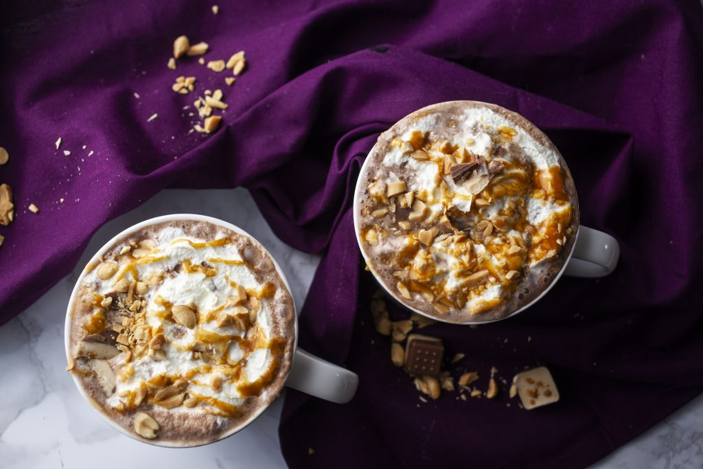 two mugs of salted caramel hot chocolate