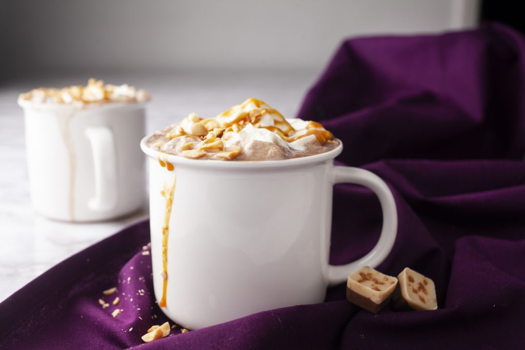 salted caramel hot chocolates in white mugs