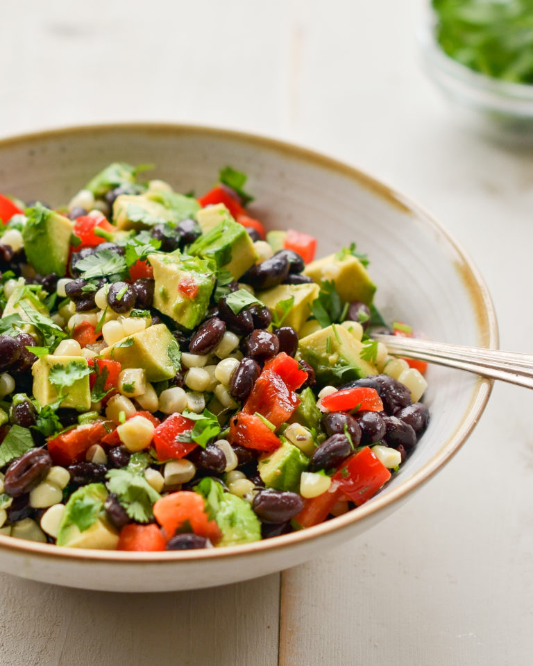 black bean salad with corn and avocado in bowl
