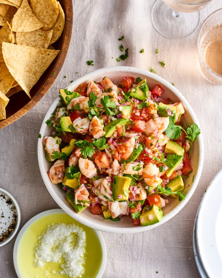 shrimp cerviche with avocado and cilantro in white bowl