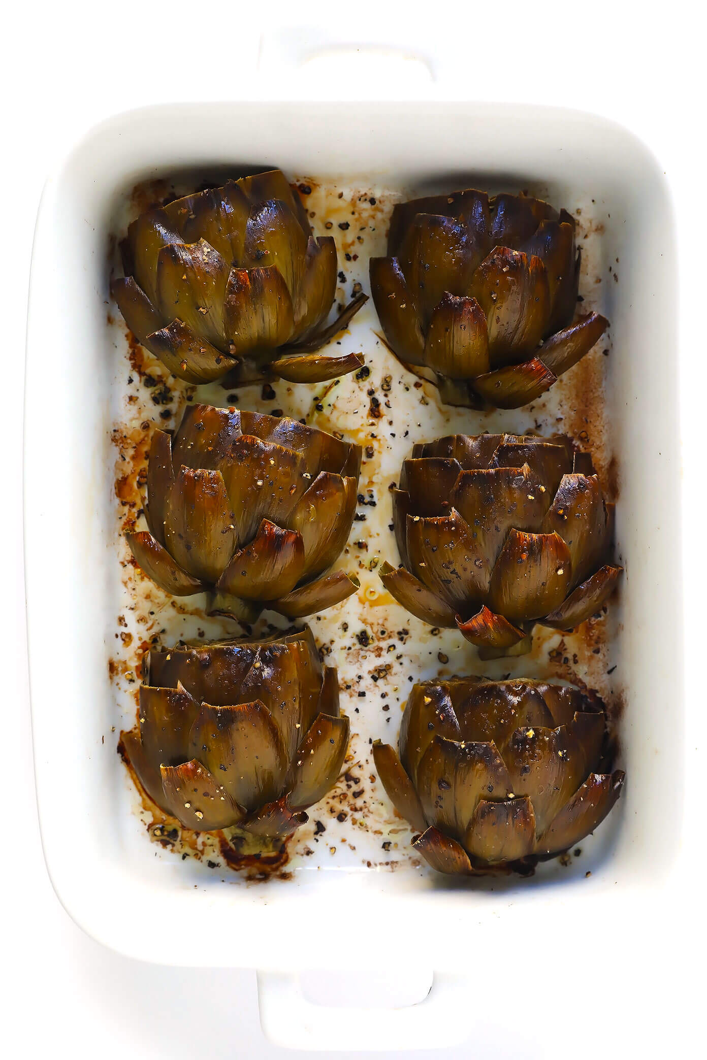 roasted artichokes in white tray