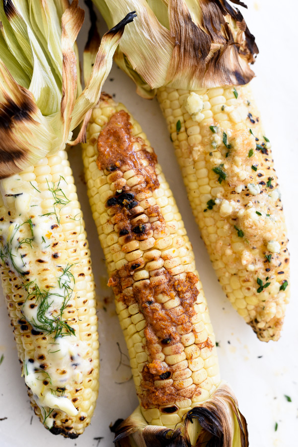 three ears of grilled corn on the cob