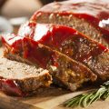 sliced meat loaf on wood block