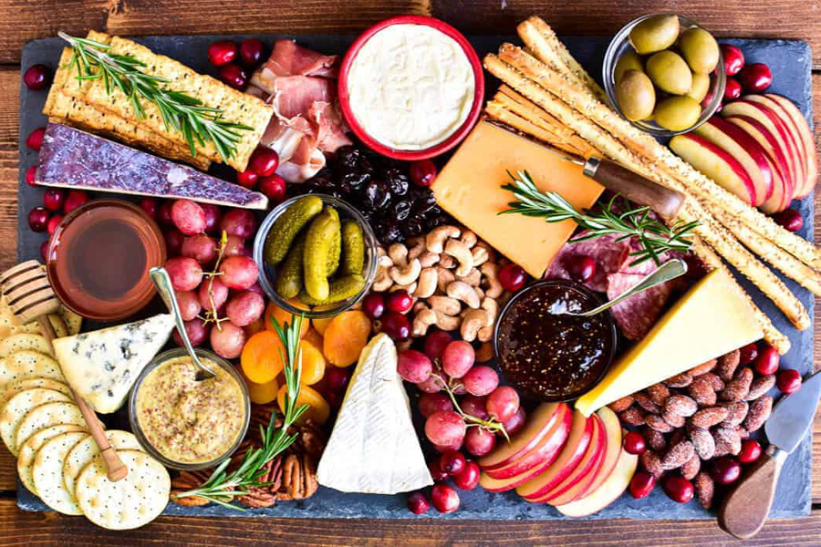 cheese platter with fruits, nuts and crackers