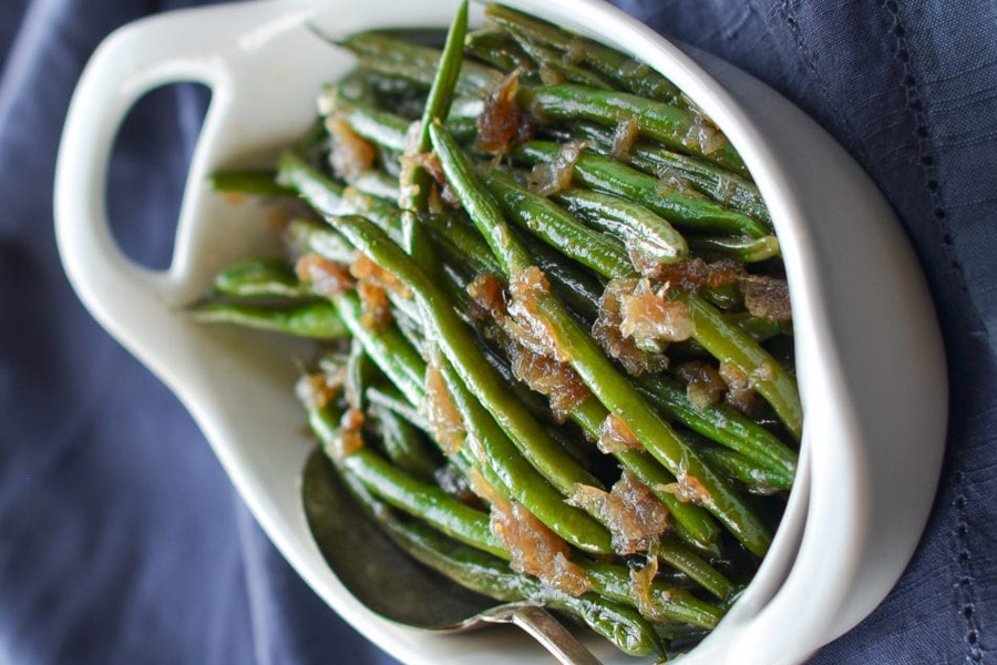 french green beans in white bowl with spoon