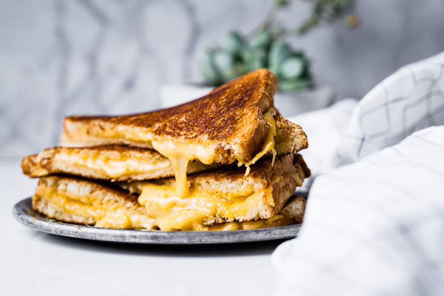 grilled cheese sandwiches on plate