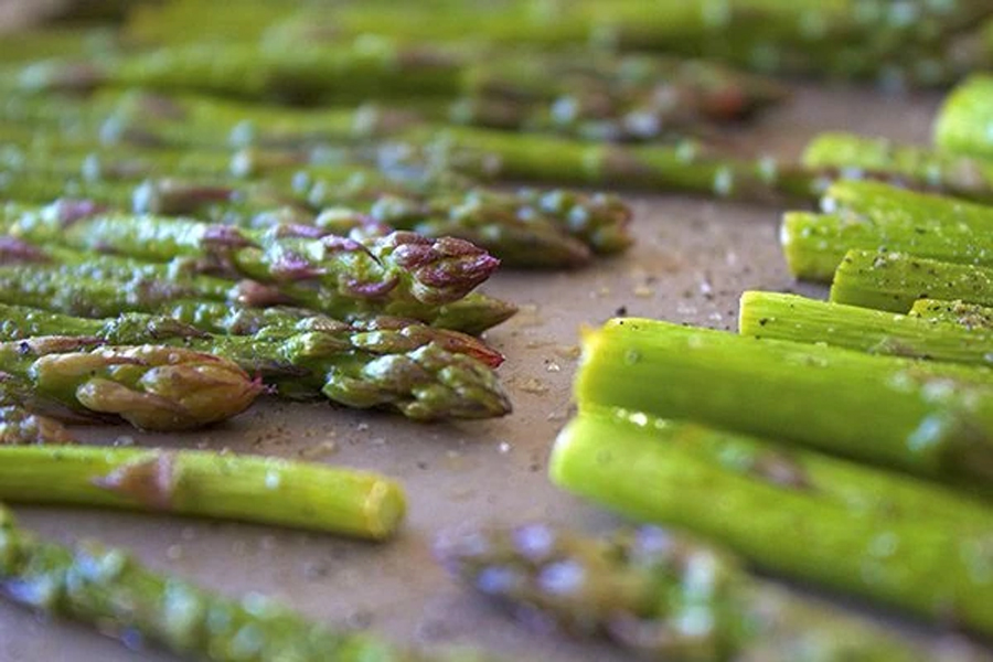 cooked asparagus on parchment paper