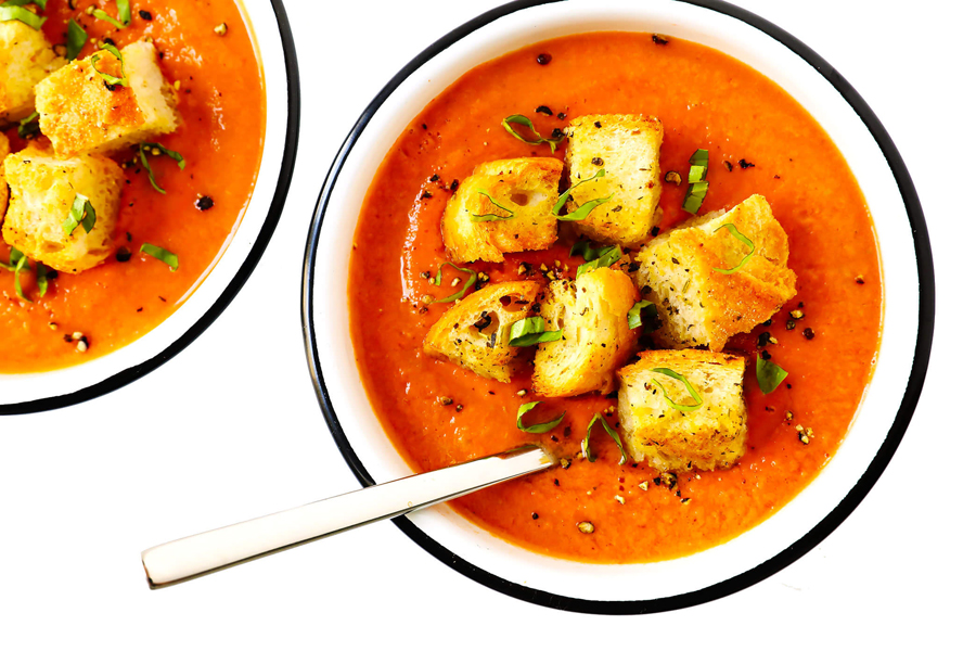 tomato gazpacho soup in two bowls with croutons