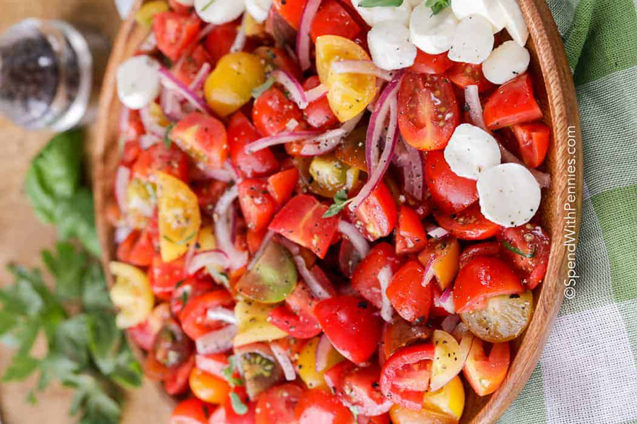 Fresh tomato salad in a wooden bowl