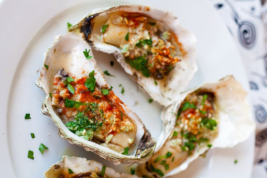 grilled oysters on white plate