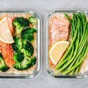 Lunch box containers with salmon, broccoli and asparagus