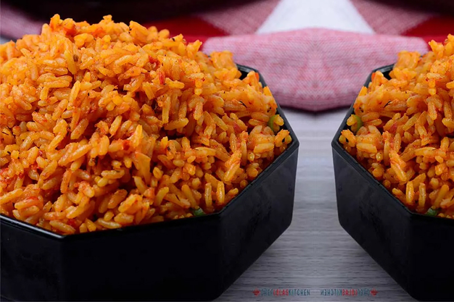jollof rice in black bowl and on black plate