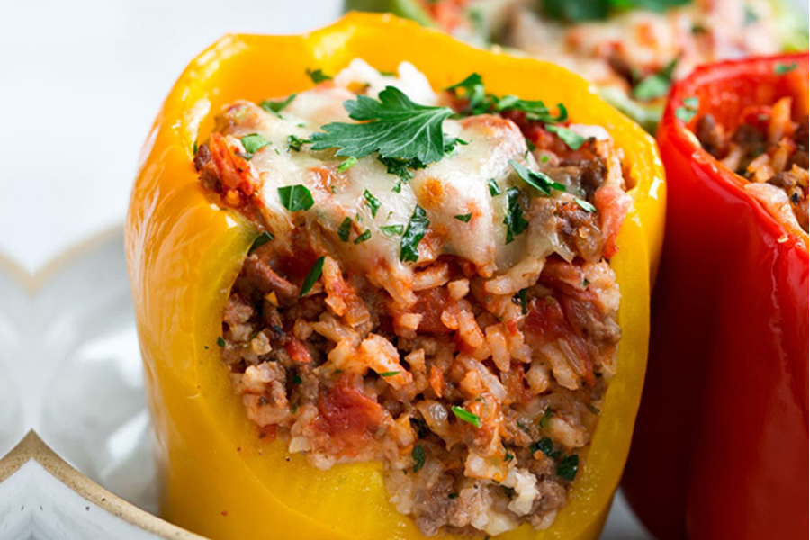 Stuffed Bell Peppers cut in half filled with ground beef, rice, tomato sauce and cheese.