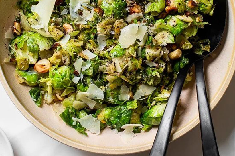 Cacio e pepe with brussel sprouts in bowl on counter