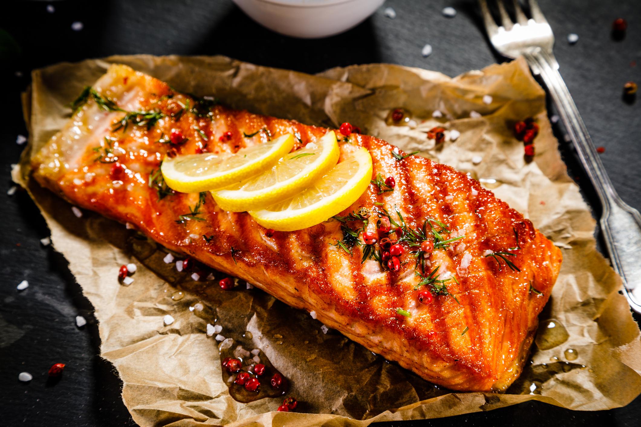salmon with lemon on parchment paper