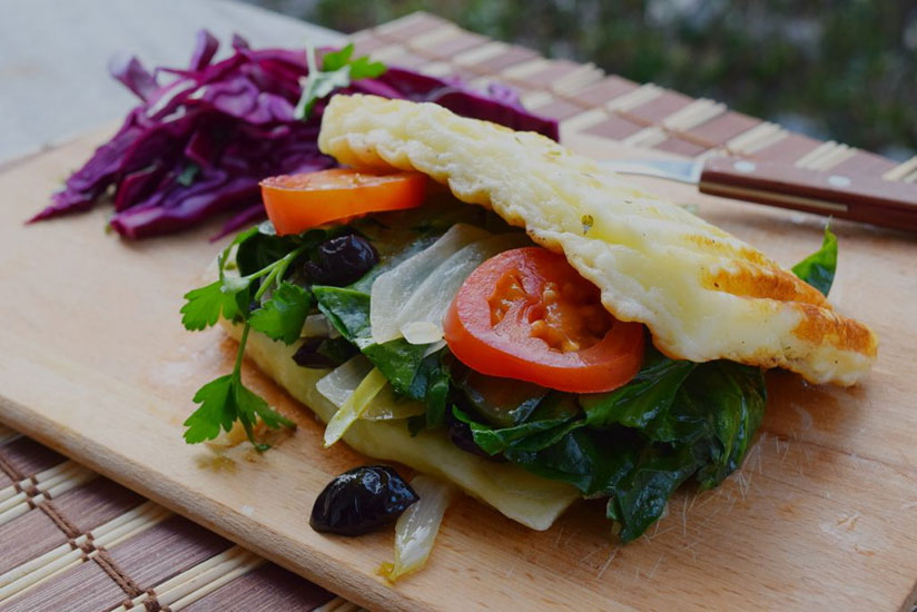 Keto grilled cheese sandwich on wood chopping board