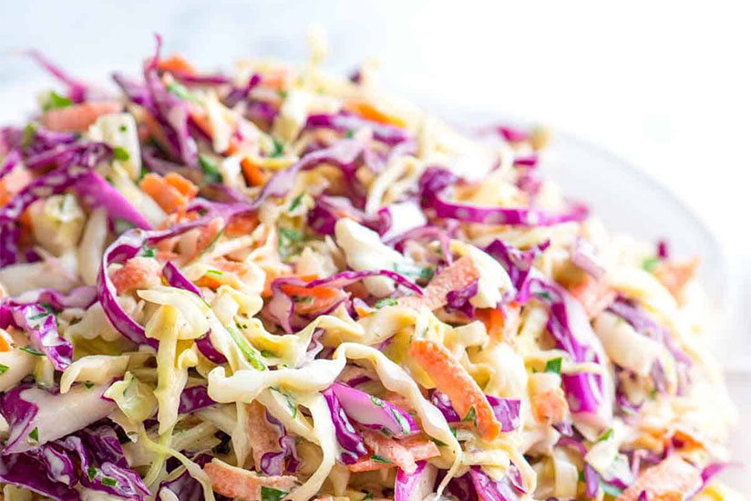 Purple coleslaw on white plate on white background