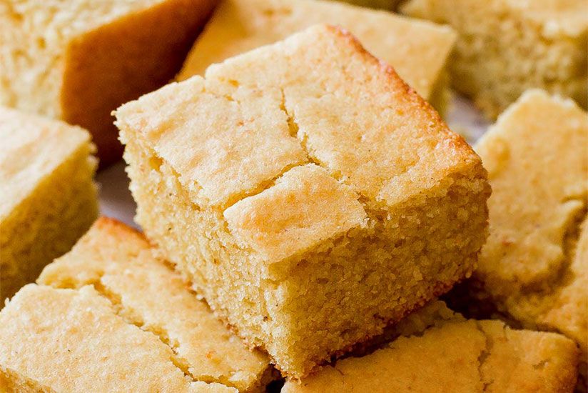 Pieces of square cut corn breads on white plate