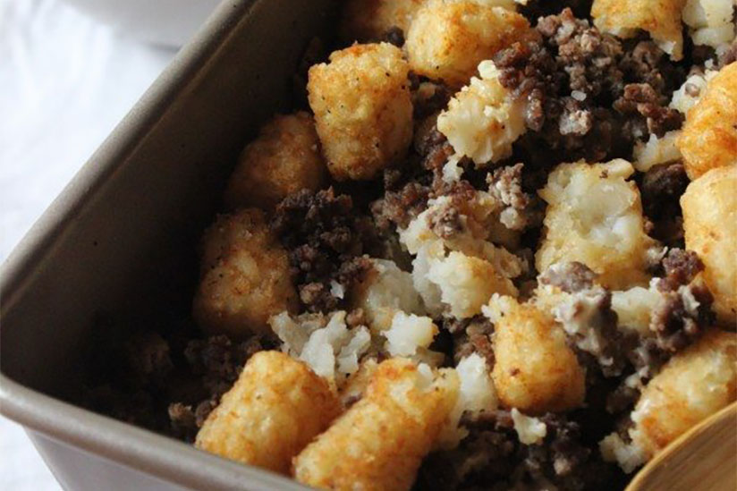 Breakfast tater tot casserole in dish on white counter