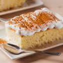 Tres leches cake sprinkled with cocoa on top