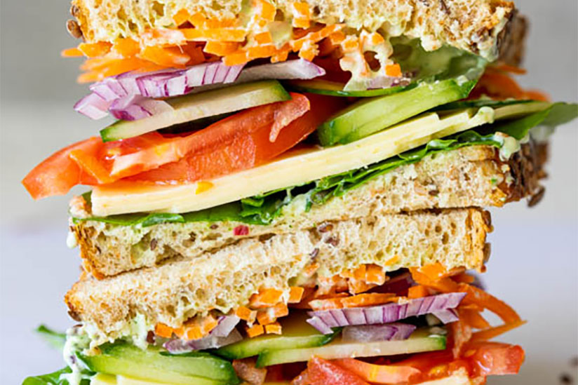 Herb mayo salad sandwich on counter on white background
