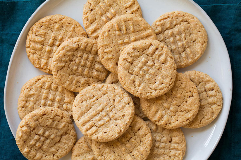 Three ingredient peanut butter cookies on white plate on counter
