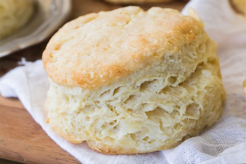 Baked buttermilk biscuit on wood tray