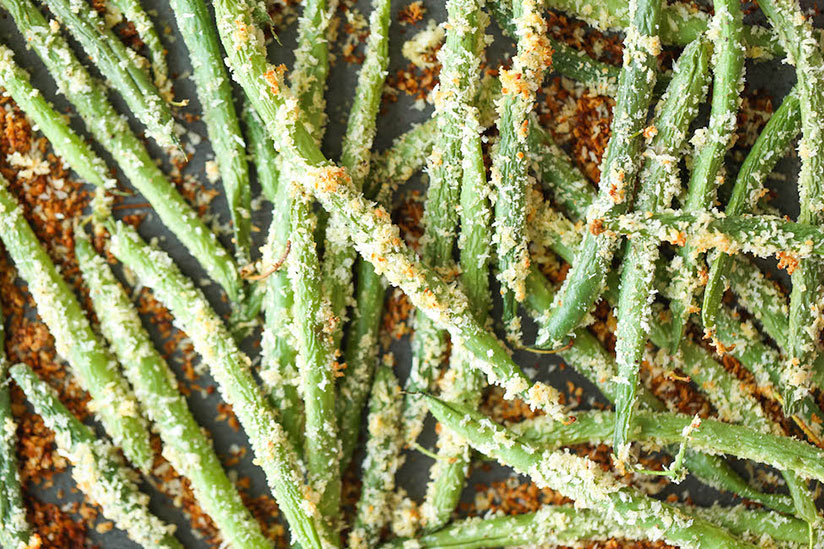 Golden brown breaded green bean fries on tray